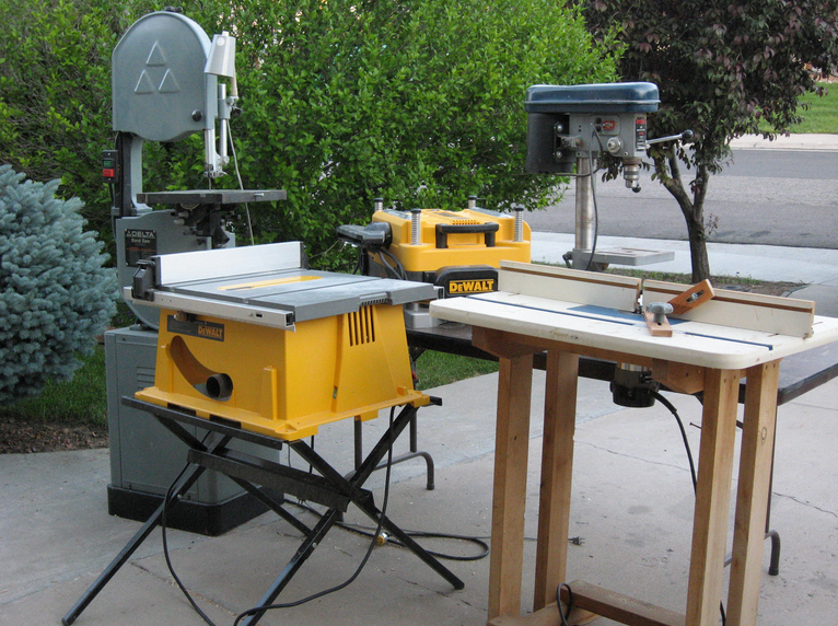 power tools including band saw, planer, table saw and router table