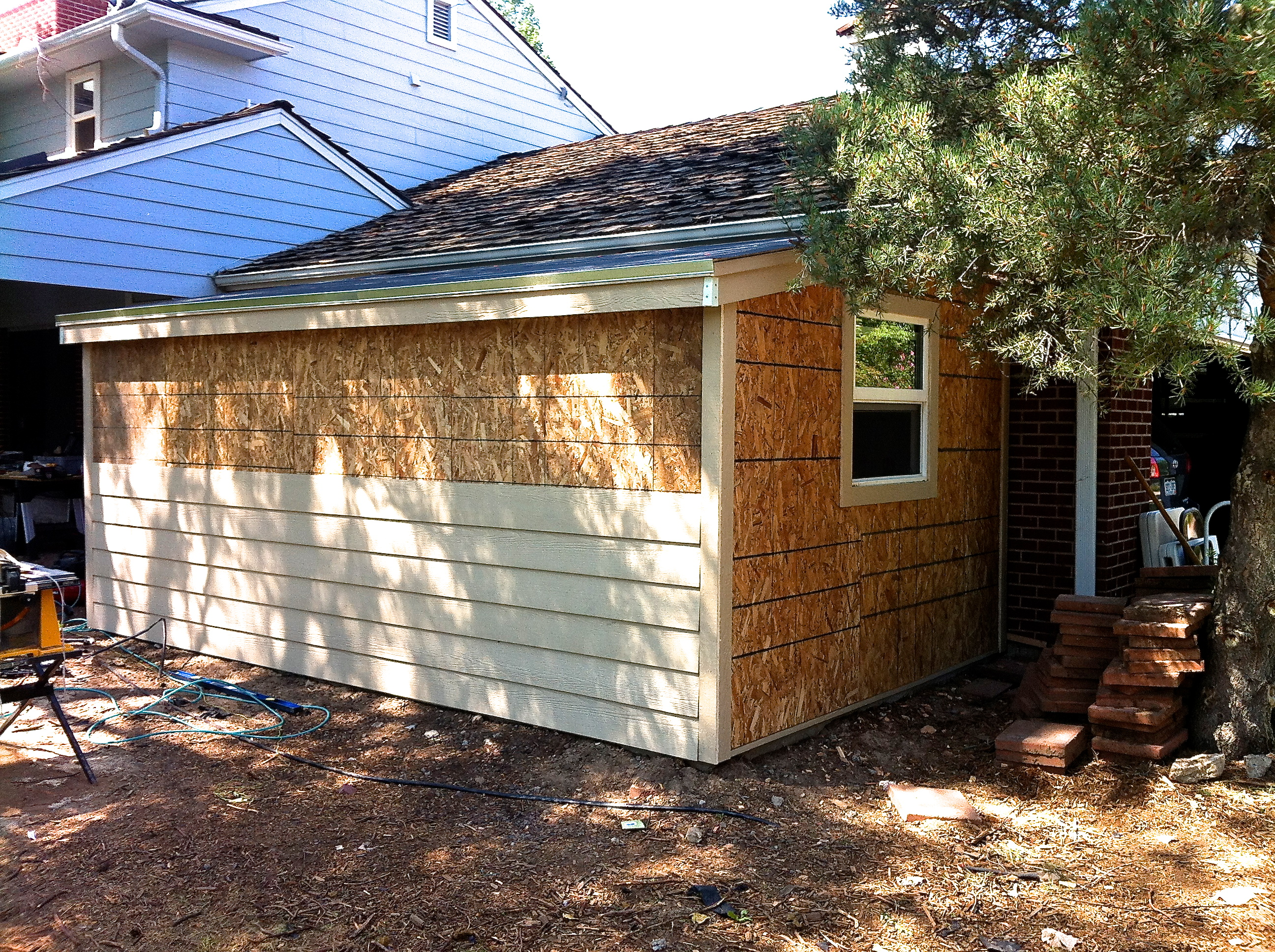 How to build a storage shed attached to your home jim for Side of the house storage shed
